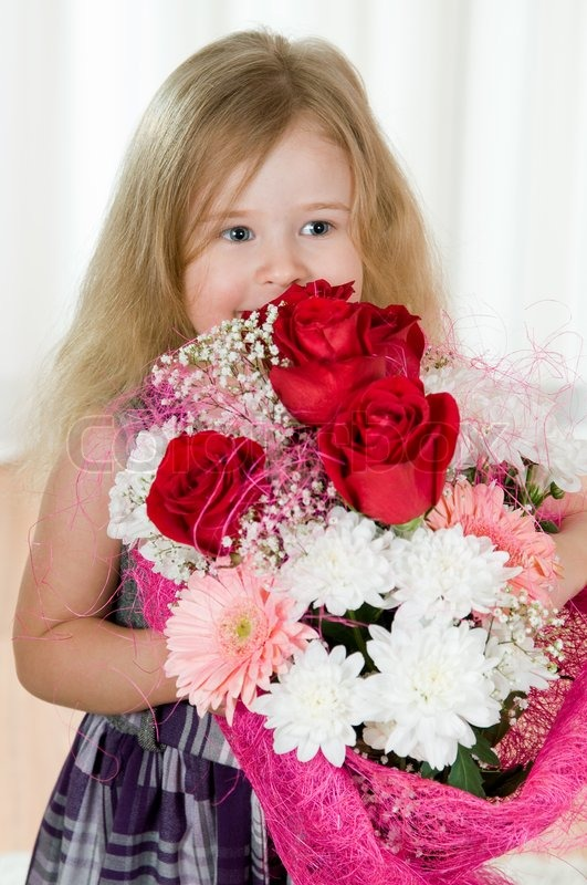 Beautiful little girl with a bouquet of flowers | Stock Photo ...