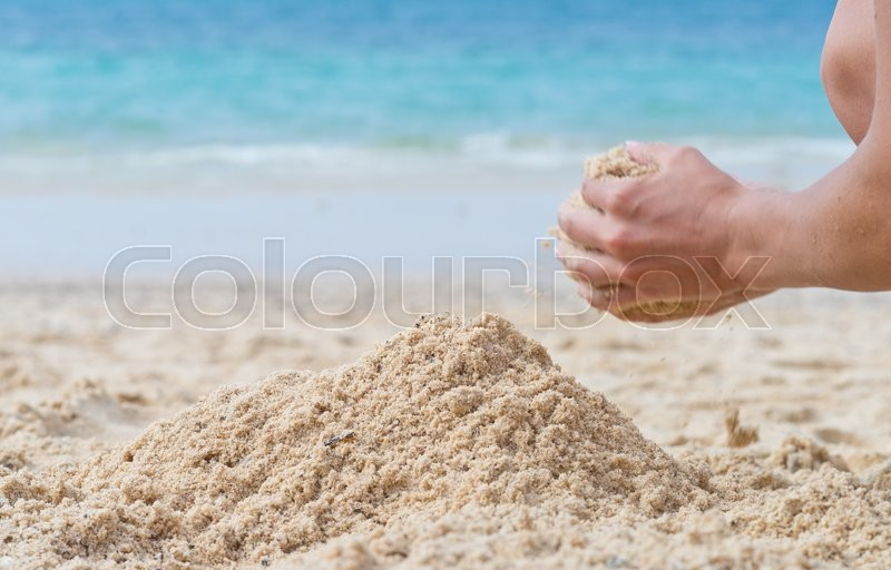 Woman hands with sand pile at the beach | Stock Photo ...