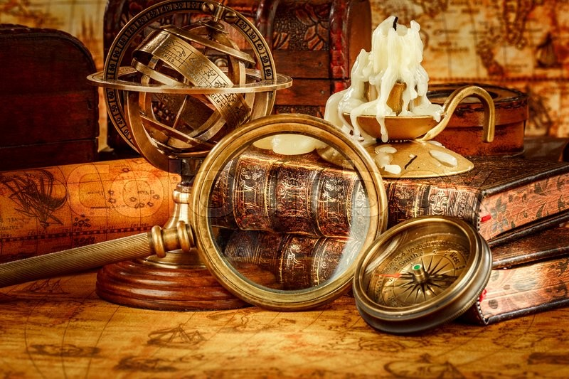 Vintage book compass telescope and a pocket watch lying on ancient vintage book compass telescope and a pocket watch lying on ancient world map in 1565 stock photo colourbox gumiabroncs Gallery