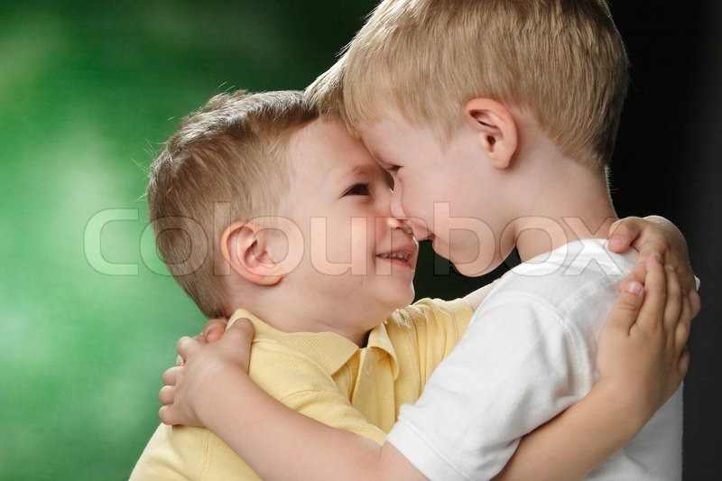 Portrait of two little boys with a smile on the face | Stock Photo ...