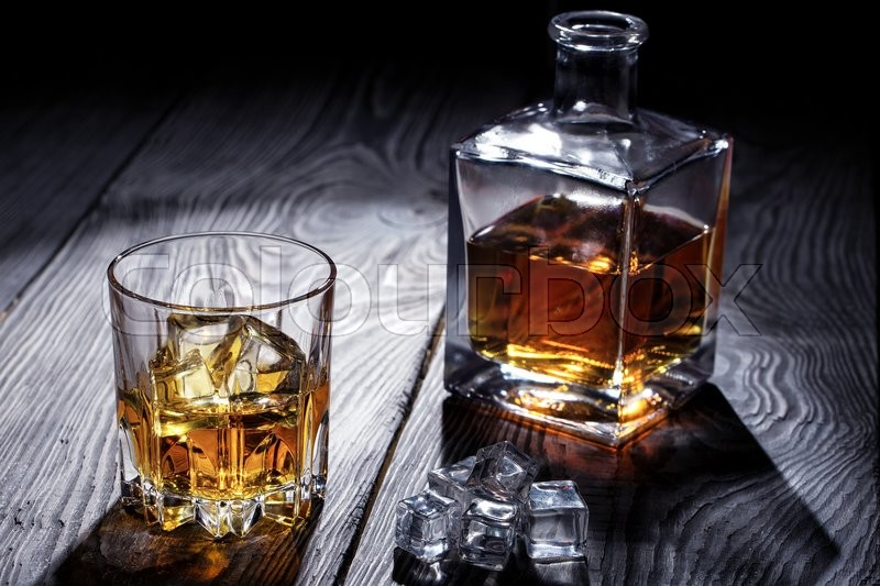 Old Whiskey Glass And Decanter On Wooden Table, Stock Photo