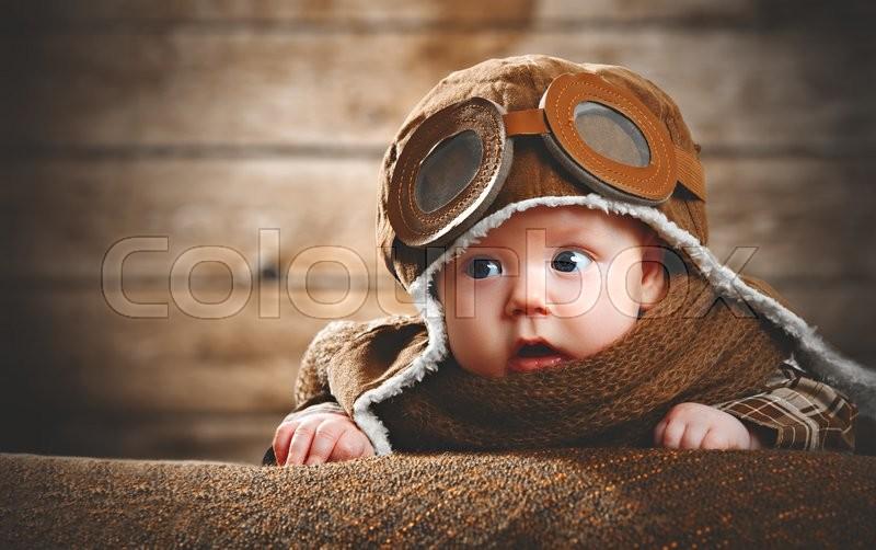 Cute pilot aviator baby newborn in brown color, stock photo