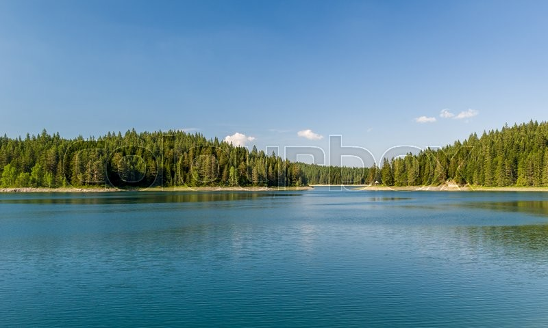 Beautiful lake with islands covered by thick conuferous forests. Mountain lake at Durmitor park, Montenegro, stock photo