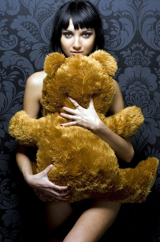 Stock image of 'Beautiful naked girl is holding th? teddy bear'