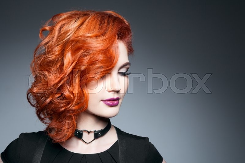Beautiful model with curly red hair . Styling hairstyles curls .Wavy shiny hair, stock photo