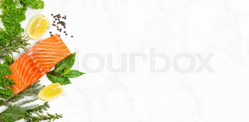 Fresh salmon fish fillet with aromatic herbs and spices on for Aromatic herb for fish