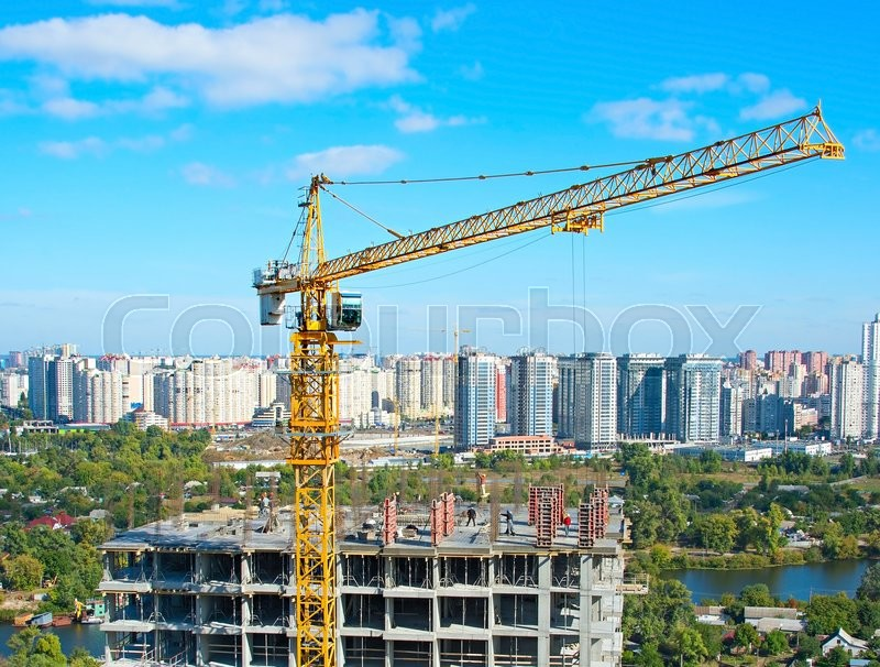 Aerial view of construction site with crane and workers in progress. Kiev, Ukraine, stock photo