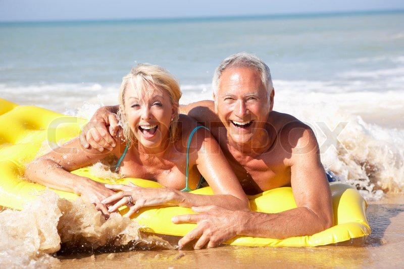 Senior couple on beach holiday