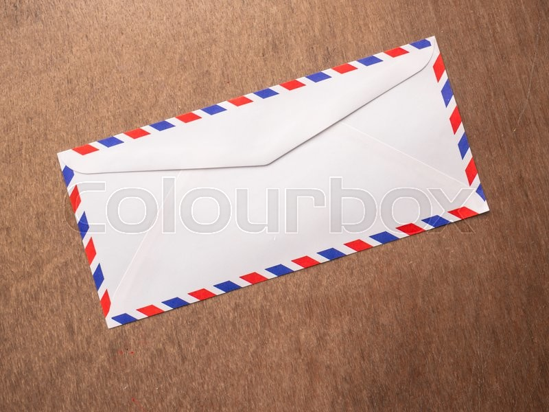 Stock image of 'Air mail letter on wood background.'