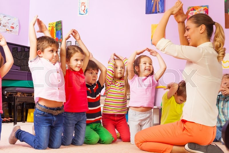 Kinder Garden: Group Of Kids Repeat Gesture After The ...