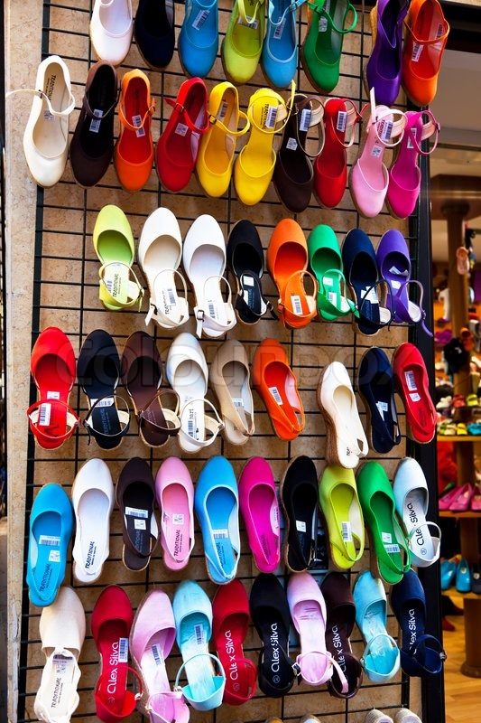 Many colorful shoes in the window of a shoe store, stock photo