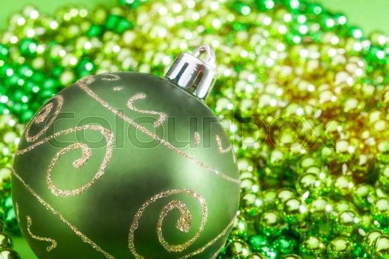 One green Christmas ball with beards closeup, stock photo