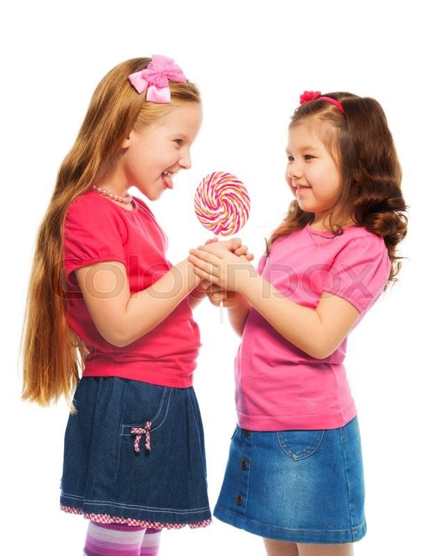 Two girls lick girls