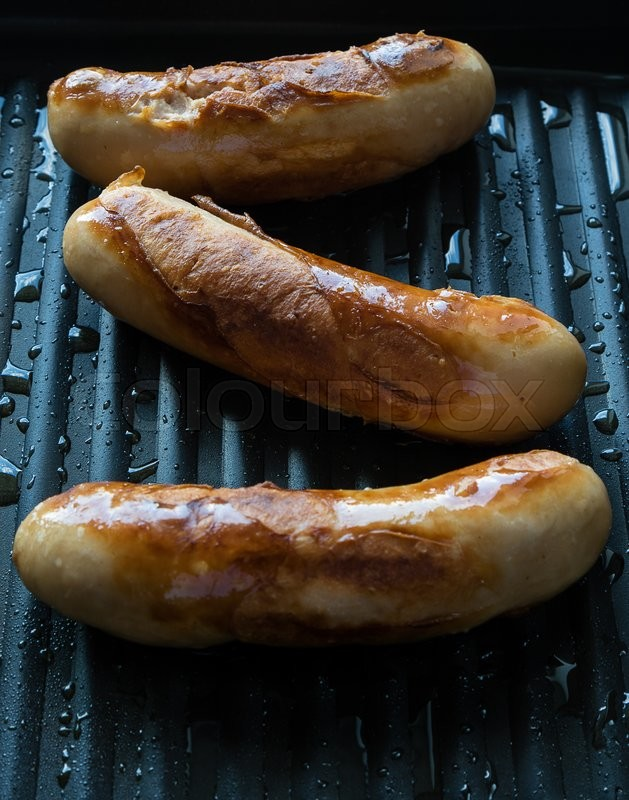 Stock image of 'fresh fried sausage in hot grill pan'