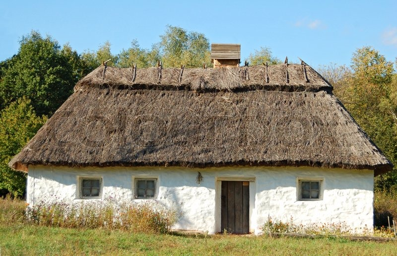 Ancient Traditional Ukrainian Rural Cottage With A Straw