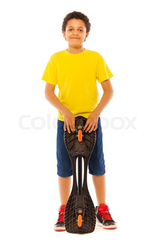 nice little african black boy standing with skate board in