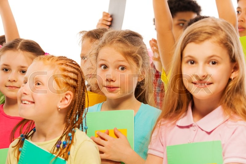 Bunch of school kids standing with textbooks, stock photo