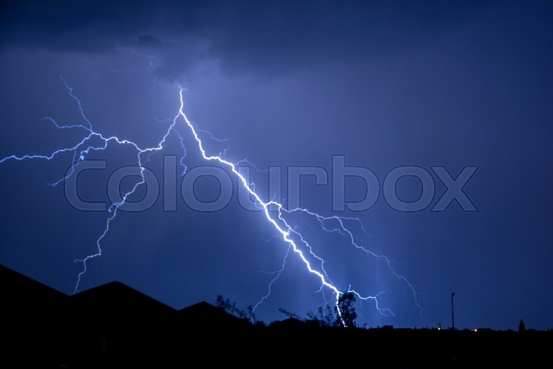 Cloud to Ground forked Lightning Strike, stock photo