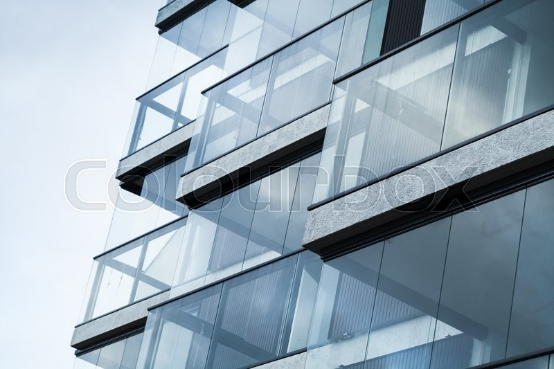 Abstract fragment of modern architecture, walls made of glass and concrete. Blue tonal filter photo effect, stock photo