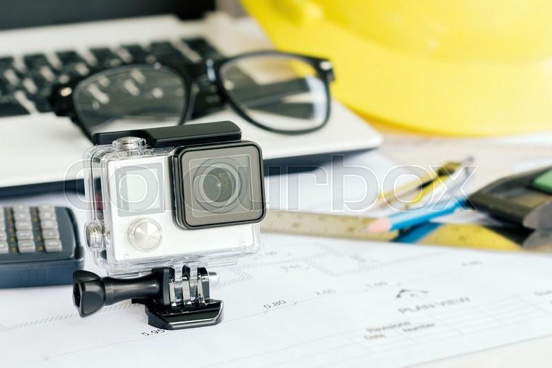 Extreme sport camera on work desk, stock photo