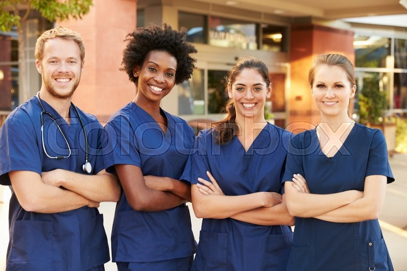 Portrait Of Medical Team Standing Outside Hospital, stock photo