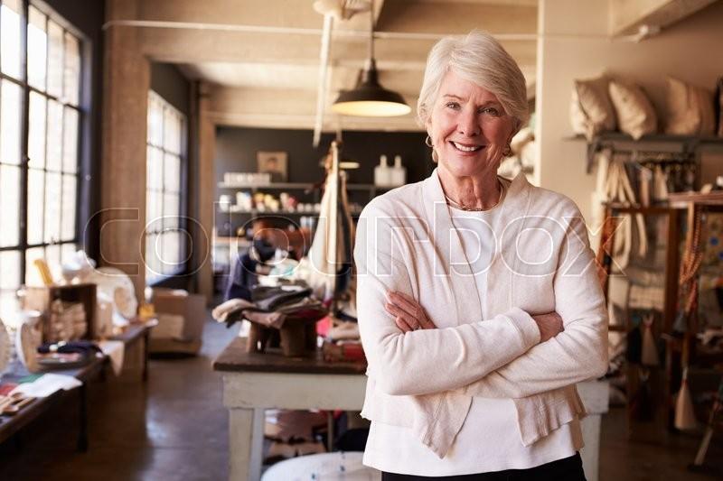 Portrait Of Senior Female Owner Of Gift Store, stock photo