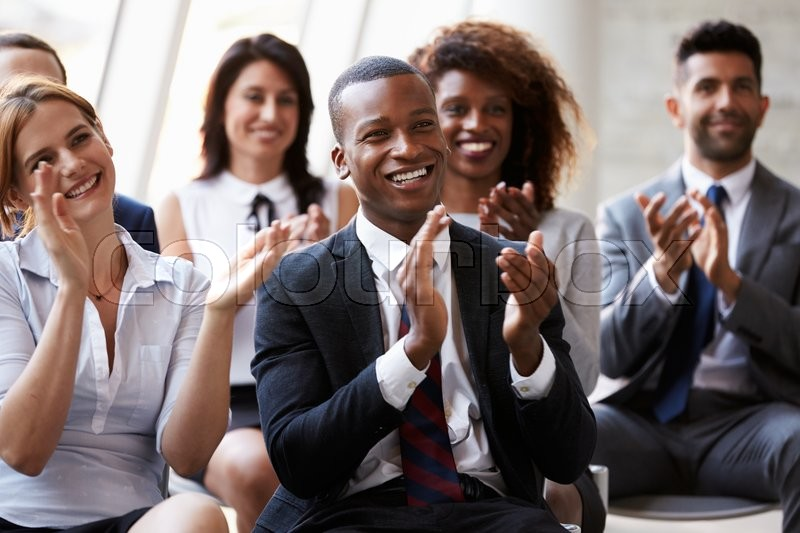 Audience Applauding Speaker At Business Conference, stock photo