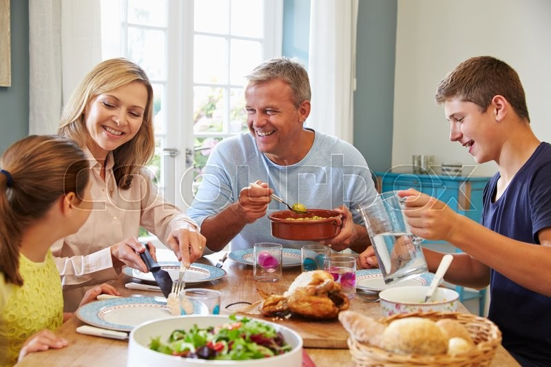 Family Enjoying Meal At Home Together, stock photo