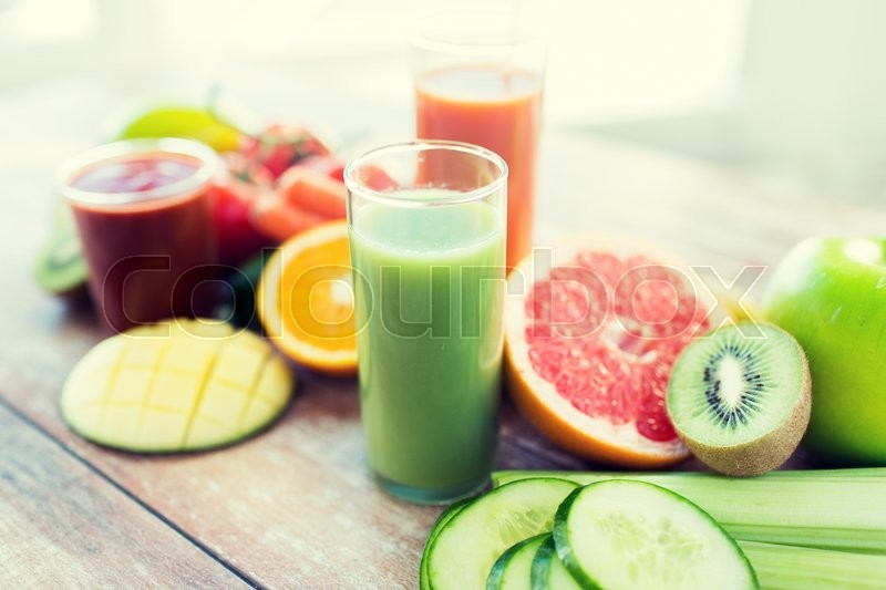 Healthy eating, food and diet concept- close up of fresh juice glass and fruits on table, stock photo
