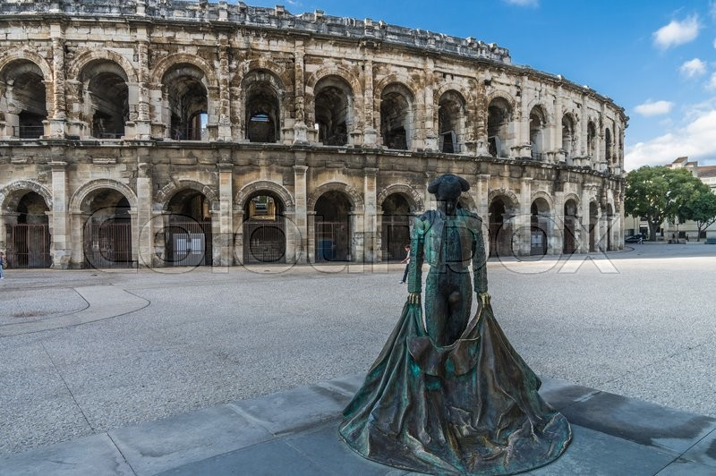 roman arena amphitheater in arles and bullfighter sculpture provence france stock photo. Black Bedroom Furniture Sets. Home Design Ideas