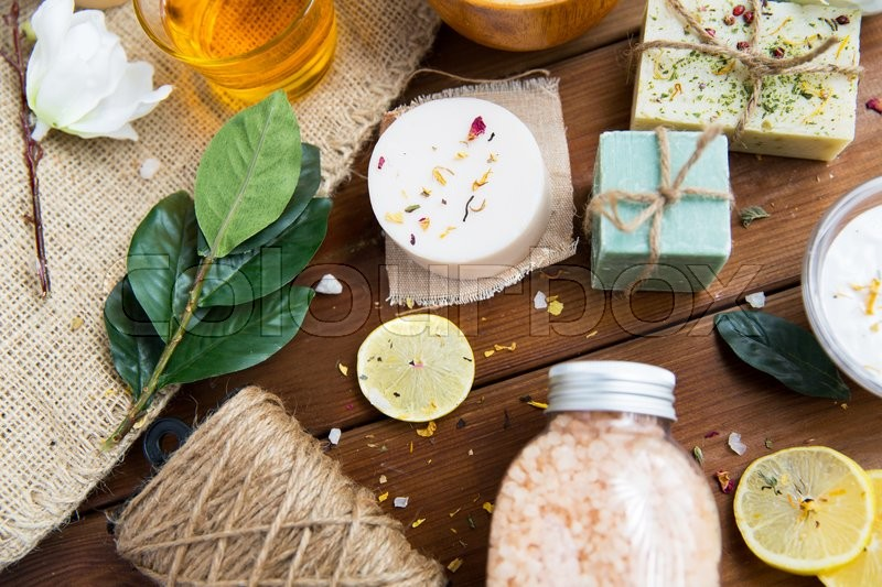 Beauty, spa, therapy, natural cosmetics and wellness concept - close up of body care cosmetic products on wood, stock photo