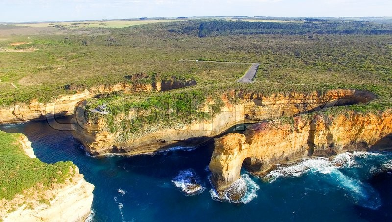 Loch Ard Gorge and Arch Island on the Great Ocean Road, aerial view, stock photo