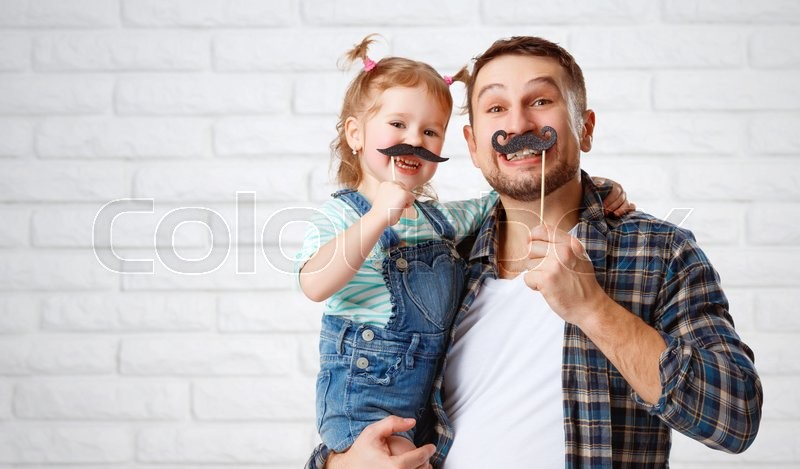 Funny family father and child daughter with a mustache, stock photo