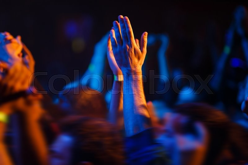Hands up in the air during a concert, stock photo