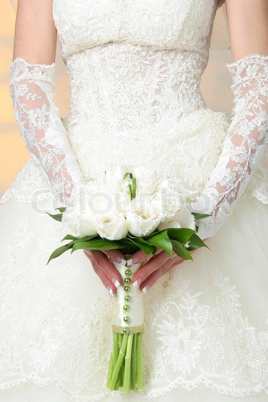 The Bride Has Control Over A Bouquet Stock Photo Colourbox