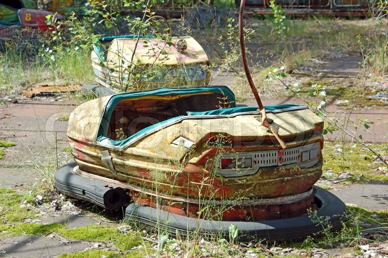 Stock image of 'Abandoned car in amusement park in Pripyat, Chernobyl area'