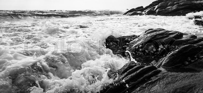 Black and white Beach rock and blue sea in Thailand, stock photo
