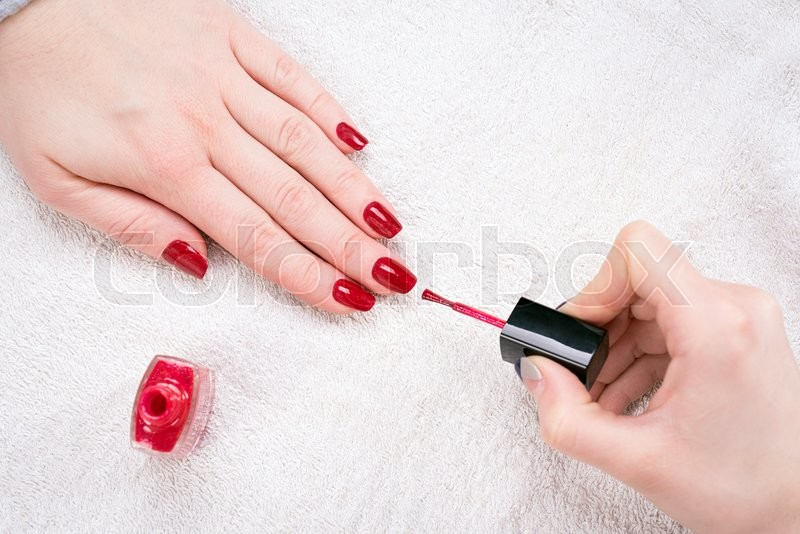 Manicured Woman39s Nails With Red Nail Polish On White Towel