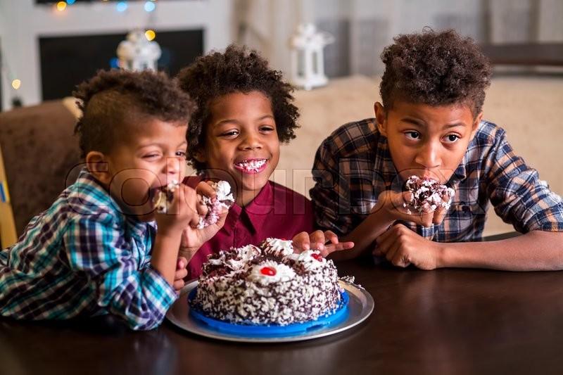 Black boys eat small cake Three kids eating small cake Enough for