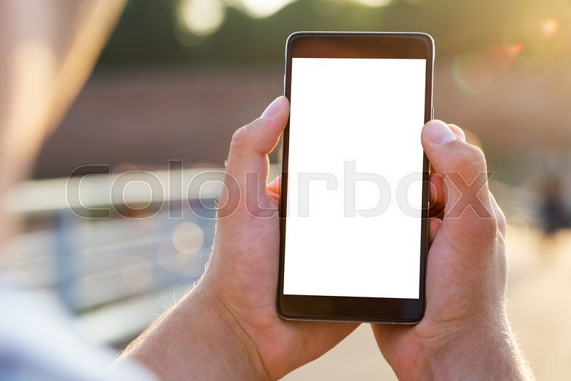 Man uses his Mobile Phone outdoor, close up, stock photo