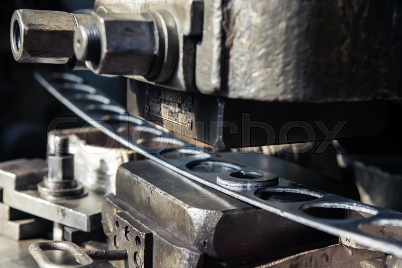 High precision sheet metal stamping and punching machinery. Old punching machine closeup, stock photo