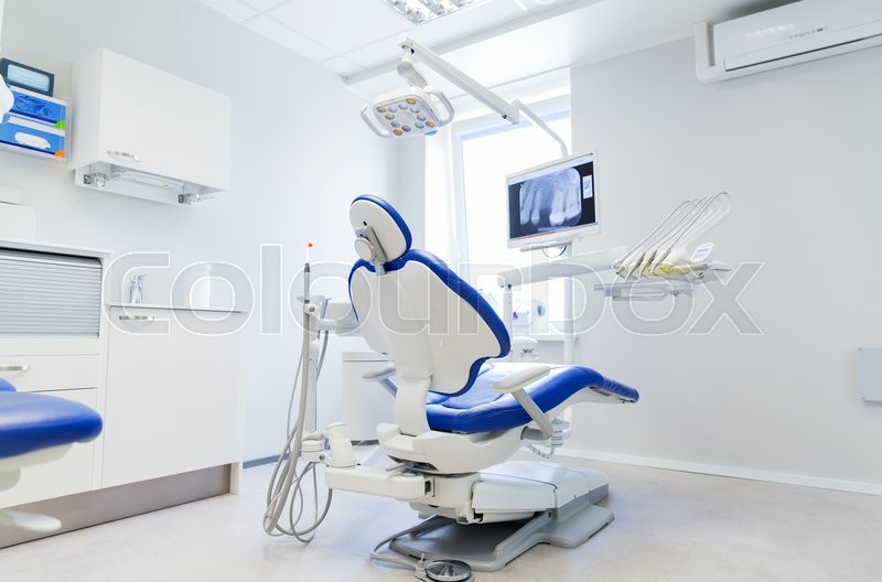 Dentistry, medicine, medical equipment and stomatology concept - interior of new modern dental clinic office with chair, stock photo