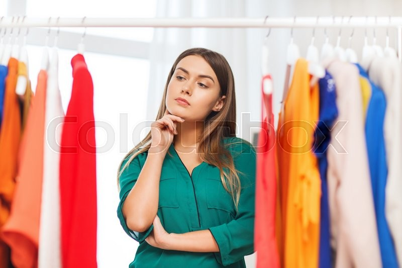 Clothing Fashion Style And People Concept Woman Choosing Clothes At Home Wardrobe Stock
