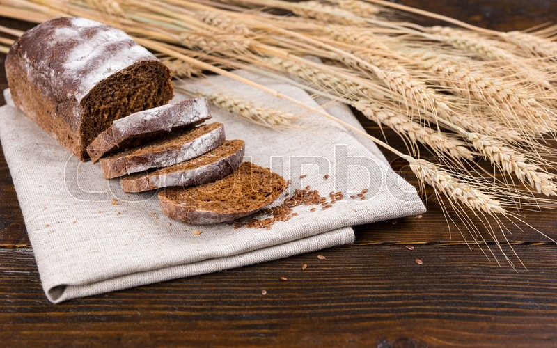Stalks of dried whole wheat stalks and grains next to ...
