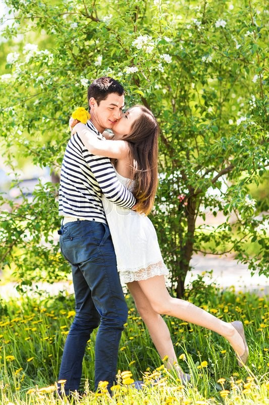 Loving Couple Under Blossoming Branches Spring Day Young