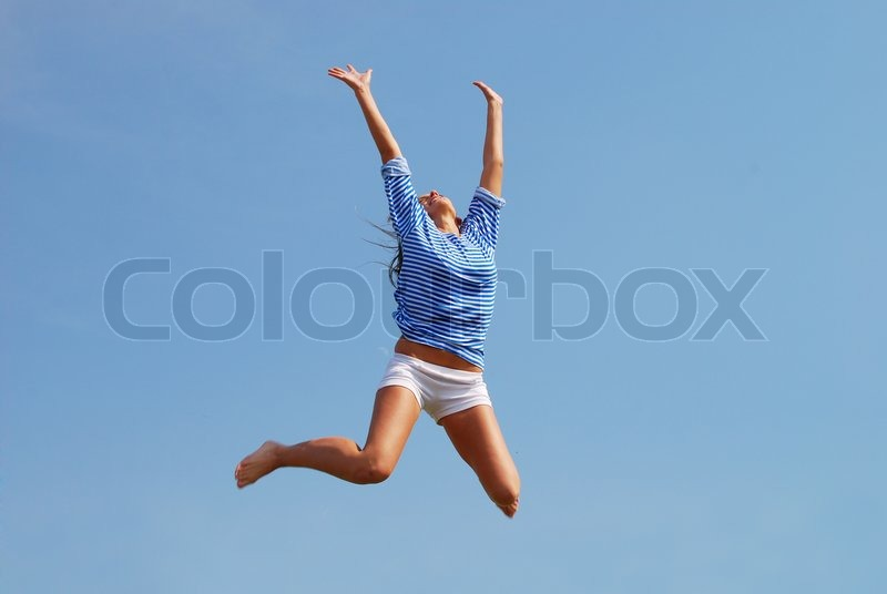 Jumping woman against sky background, stock photo