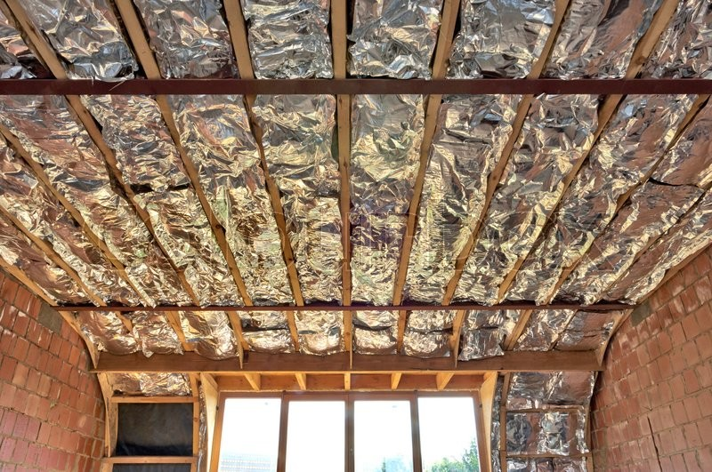 Fiberglass Batt Insulation Between Roof Trusses At A House