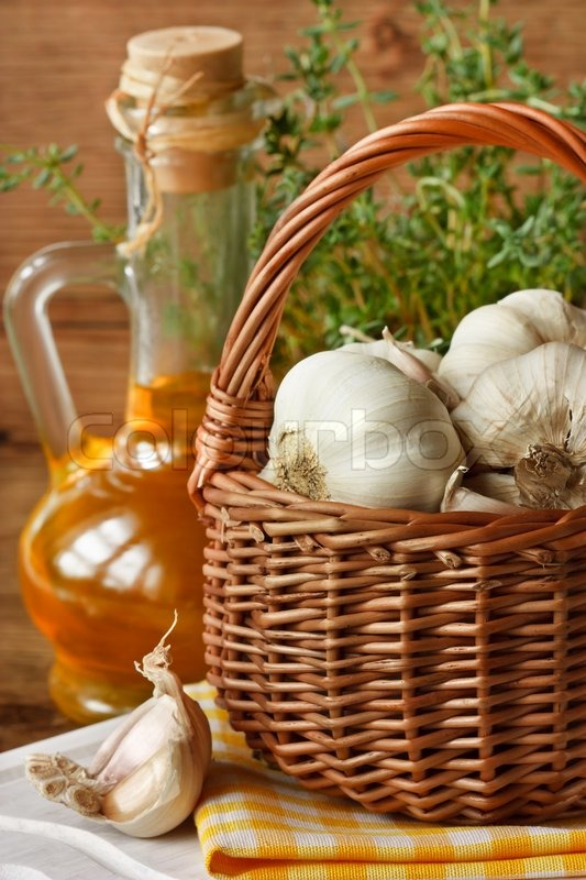 Garden garlic on basket, thyme and olive oil. | Stock ...