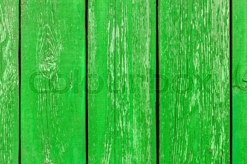 Different shades of green texture wood planks as a background nature. Peeling paint on an old green wooden boards. The texture of old wood as background. Country style, stock photo