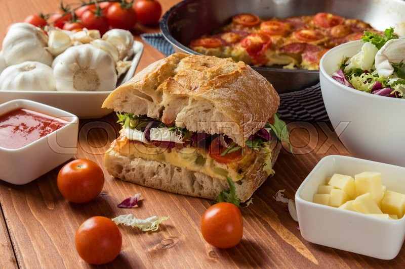 Big frittata ciabatta sandwich on breakfast table | Stock Photo ...